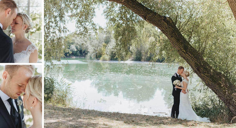 Hochzeitspaar in Lenzberg vor einem See.